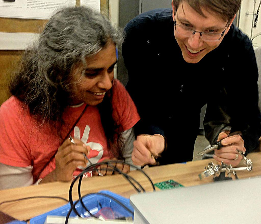 Hartmann with a student in the Interactive Device Design class