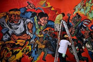 FIlipino activists apply the finishing touches...