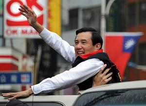 Taiwan President Ma Ying-jeou waves to support...