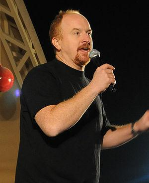 English: Comedian Louis C.K. performs for serv...