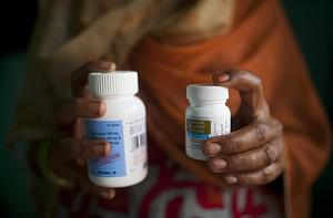 An Indian HIV-infected women poses with her an...