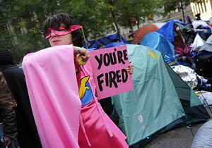 A costumed Occupy Wall Street dressed as 'The ...