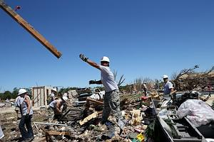 MOORE, OK - JUNE 02: Workers with Team Rubicon...