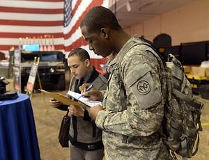 "Soldiers fill out applications during the ""Hir..."