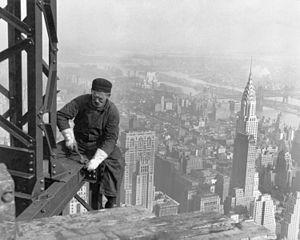 Photograph of a Workman on the Framework of th...