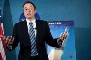 SpaceX CEO Elon Musk unveils the Falcon Heavy ...