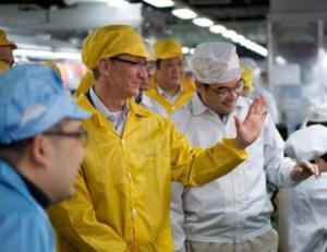 Apple's Tim Cook visits a production facility in 2012. (Credit: AP)