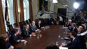 President Barack Obama, left, flanked by Treas...
