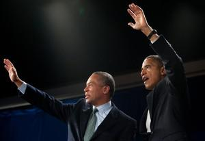 US President Barack Obama waves alongside Demo...