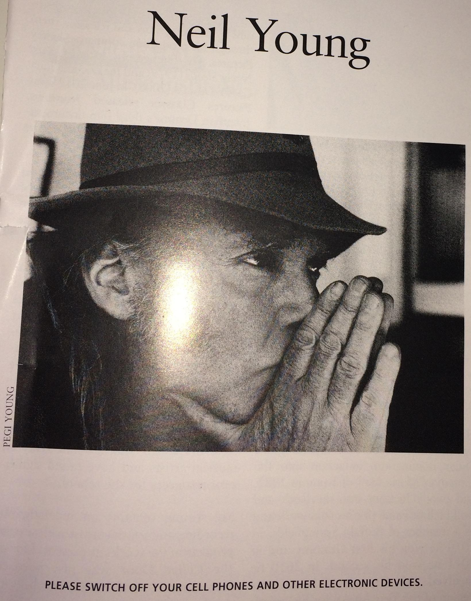 Page from the Neil Young Carnegie Hall Playbill showing the often ignored request to turn off cell phones and other electronic devices.