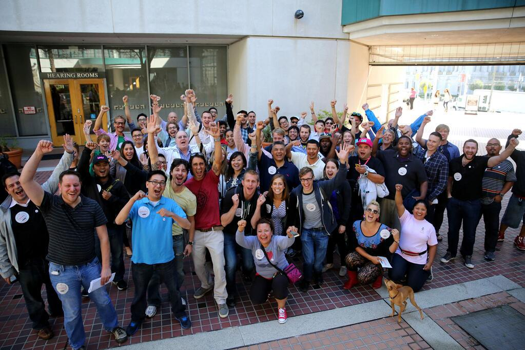 Supporters of the new ridesharing ruling celebrate (Photo credit: Lyft)