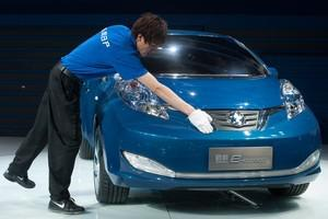 A man cleans a concept electric car by joint N...