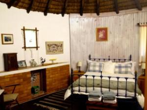 A thatched rondavel guest room