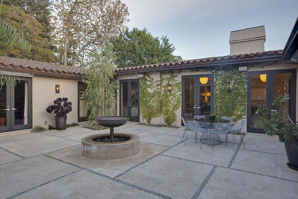 A gorgeous enclosed patio -- a perfect way to enjoy the warm California sun in privacy