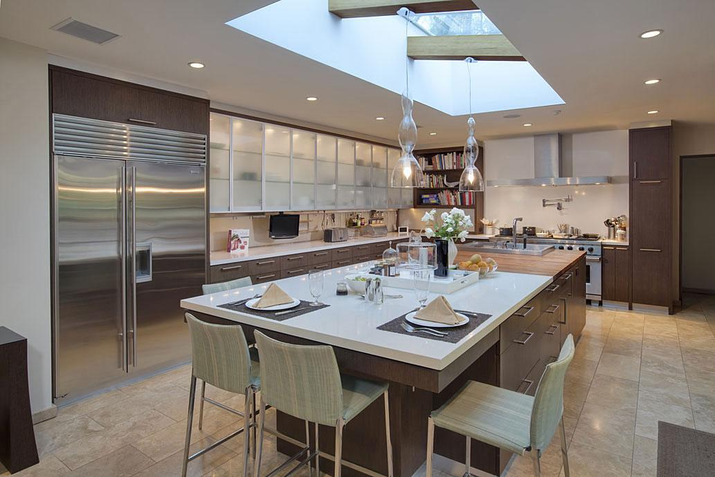Stunning chef's kitchen features all the high-end appliances that you would expect