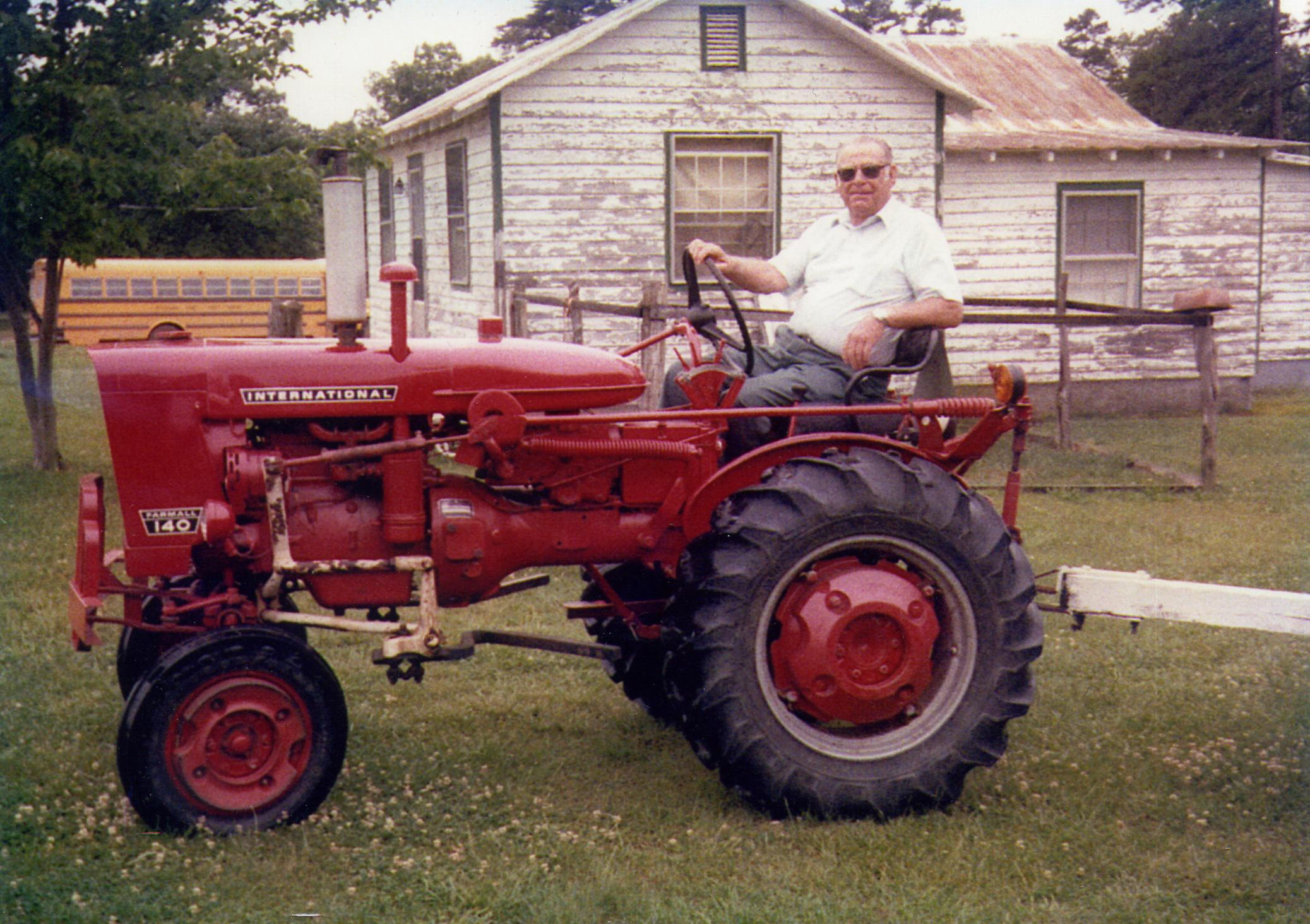 Grandpa Crews on the Tractor