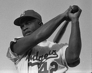 Jackie Robinson swinging a bat in Dodgers unif...