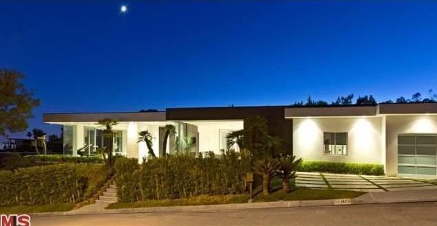 This Trousdale Estates home is listed by Jade Mills.