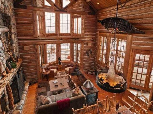The living room of Mitt Romney's new home features whole logs in its construction.